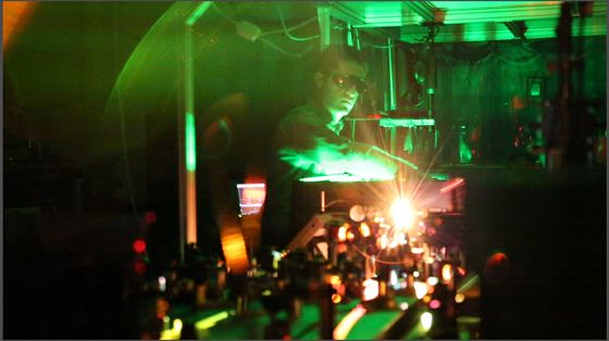 UNM Research Assistant Aram Gragossian tests lasers in one of the Department of Physics & Astronomy's optics laboratories. Image courtesy of University New Mexico.